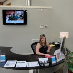 Maggie at the Biggest Receptionist Desk in the World