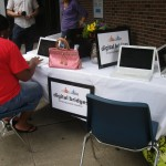 Digital Bridges at the Public Library Sale in Milledgeville trying to make people fill out an online survey. Whew.